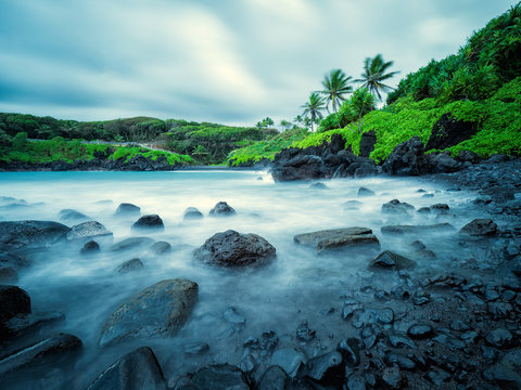 This photo is from Waianapanapa State Park in Maui, Hawaii, which is just outside of Hana.  Black sand beach can be seen in the distance.