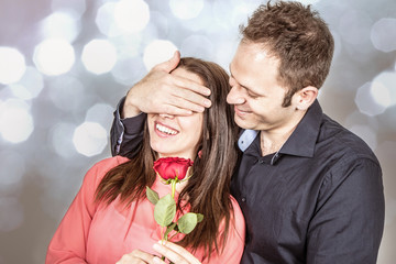 Valentine's day : man in love gives a rose to his beloved
