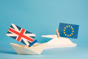 paper ship with Flags of European Union  and United Kingdom, Brexit UK EU   concept shipment or free trade agreement and membership
