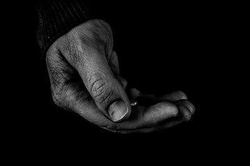 Helping hands concept, Man's hands palms up holding money coins, need care and support, poor man, black and white