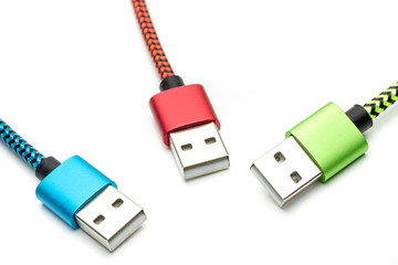 Three colorful usb cables for smartphone isolated
