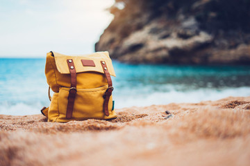 Hipster swimming mask on background blue sea ocean horizon, hiker tourist yellow backpack on sand beach, panoramic seascape blank, traveler relax holiday concept, sunlight view in trip vacation