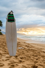 Surfboard on Sunset Beach in Hawaii at sunset