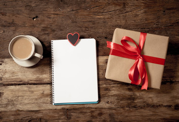 Conceptual Valentines image of note book with space for text, heart shaped chocolates and coffee
