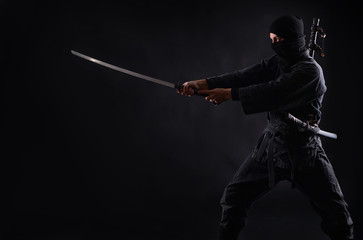 Ninja, samurai warrior on a dark background