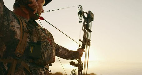 57bd0934cd7473 0 11 Orbit shot of experienced bowhunter poised to shoot his arrow