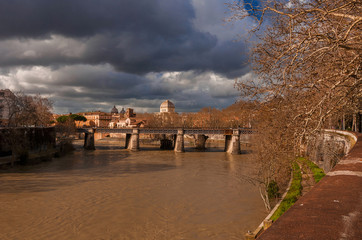 Sunny and cloudy day in winter Rome along River Tiber