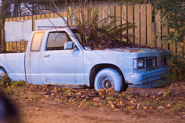 abandoned pick-up truck by old fence