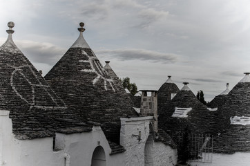 mysterious and magical signs painted on the Apulian trulli in Alberobello town