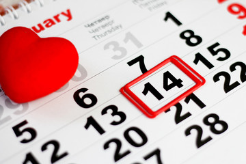 Calendar with red mark on 14 February. Red hearts decoration. Valentines day concept
