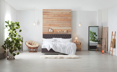Large comfortable bed in stylish room. Modern interior design Wall mural