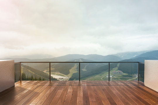 Balcony view of  mountains. Landscape. Sunny Day. Terrace with a beautiful view.