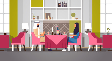 arabic couple sitting cafe table romantic dinner happy valentines day celebration concept arabic man woman love dating modern restaurant interior horizontal flat