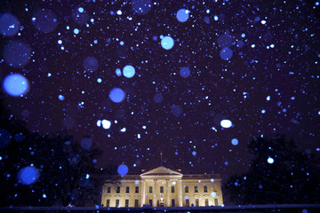 Snow from Winter Storm Gia falls over the White House as the partial government shutdown becomes the longest in U.S. history in Washington