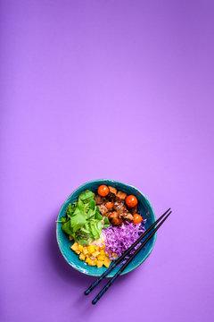 Hawaiian poke bowl with rice, beef.Asian kitchen.