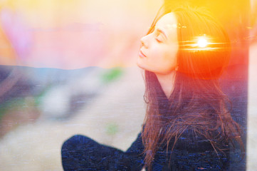 Double multiply exposure portrait of a dreamy cute woman meditating outdoors with eyes closed, combined with photograph of nature, sunrise or sunset. closeup. Psychology power of mind concept. Wall mural