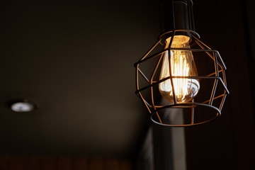Wall Mural - Beautiful vintage luxury light lamp hanging decor glowing in dark. Retro filter effect style.