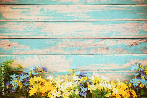 Wall mural flowers blossom on vintage wooden background, border frame design. vintage color tone - concept flower of spring or summer background
