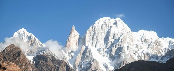 Panoramic view of snow capped Hunza peak and Ladyfinger peak. Hunza valley, Gilgit Baltistan, northern Pakistan.