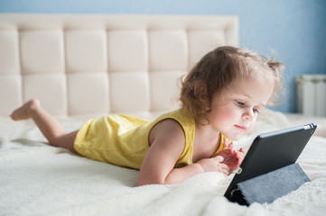Happy child with tablet computer.