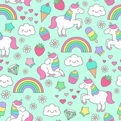 Cute pastel hand drawn unicorn and doodle elements seamless pattern background
