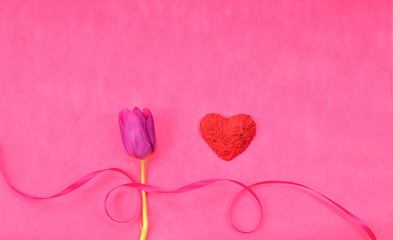 Valentines Day background with purple tulip, red heart and pink ribbon