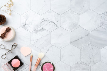 make up cosmetic flat lay top view on the tile marble white color look clean with copy space for text