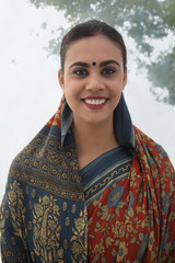 Portrait of a smiling village woman in saree.