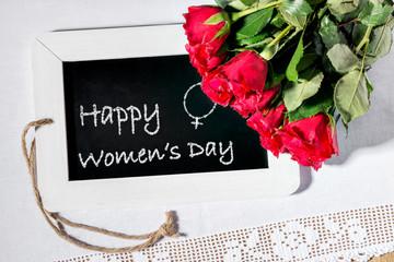 Image of a slate blackboard with chalk message Happy Women's Day
