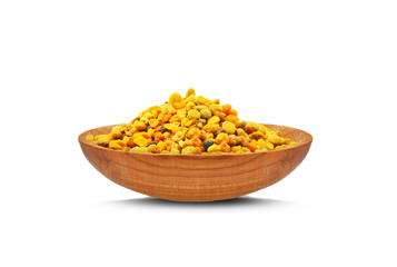 bee pollen and wooden bowl isolated on a white background