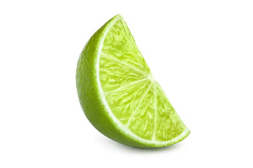 Ripe slice of green lime, isolated on white background