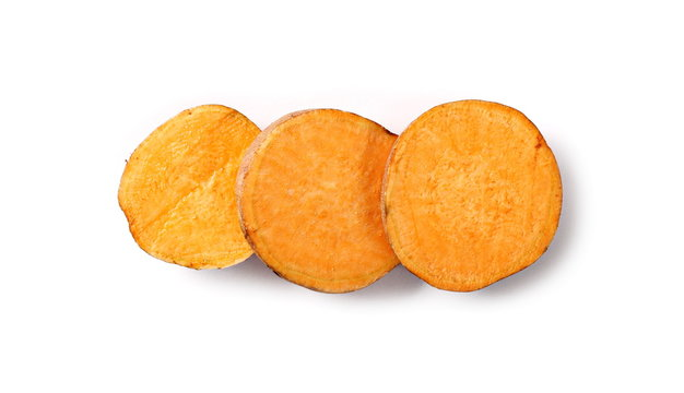 Sweet potato slices isolated on white background, top view