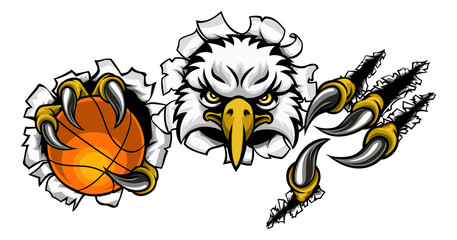 An eagle bird basketball sports mascot cartoon character ripping through the background holding a ball