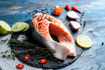 Piece of fresh salmon on wooden table