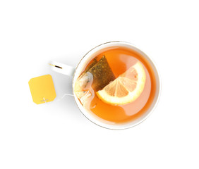 Cup of hot tea with lemon on white background