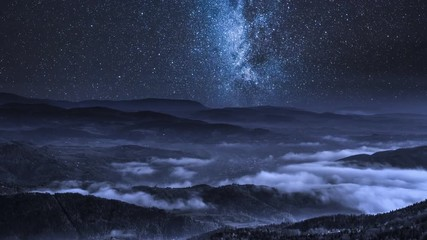 Fototapete - Milky way over flowing clouds in the Tatra Mountains, Poland