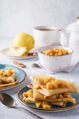 Crepes with caramelized quince and apple for dessert.