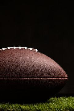 American football ball on dark background
