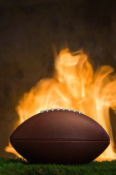 American football ball with fire at the background