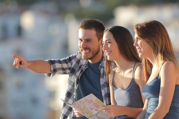 Group of tourists contemplating views on vacation