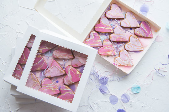 Boxes with cookies in the form of marble hearts for gifts