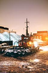 tug at night in port