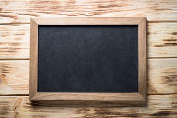 Chalckboard on wooden table.