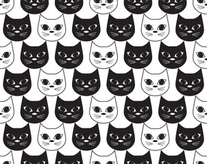 The vector illustration is a lot of white and black cats. Seamless pattern a background from nice attractive faces of animal white and black cats. Flat design. Monochrome.