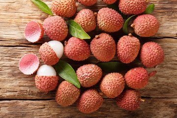 litchi, lichee, lychee, or lichi, Litchi chinensis on old rustic wood background. Horizontal top view