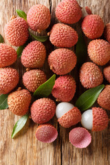 litchi, lichee, lychee, or lichi, Litchi chinensis on old rustic wood background. Vertical top view