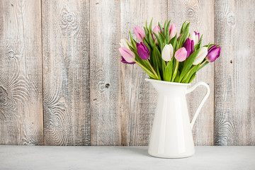 Fresh colorful tulips in a jug