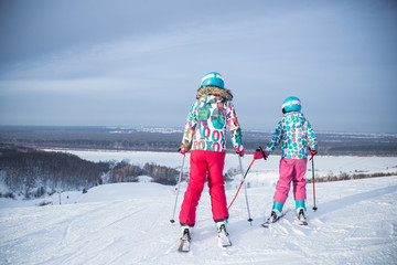 little girls skiing to slope