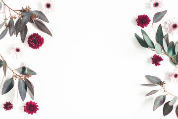 Flowers composition. Eucalyptus leaves and pink flowers on white background. Flat lay, top view, copy space