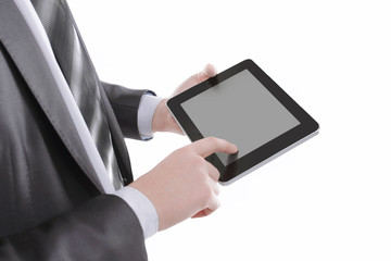close up.businessman tapping the screen of the digital tablet